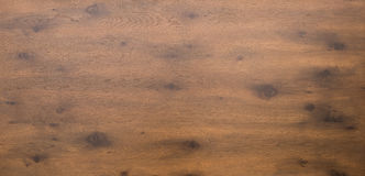 Wooden table top in dark timber. Aerial or above shot of a dark wooden table top with timber and knots Royalty Free Stock Image
