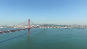 Aerial from the 25 Abril bridge and the river Tejo in Lisbon Portugal stock video footage