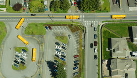 Aerial Abstract View of Multiple School Buses. Aerial shot of five school buses all leaving a school in Lynnwood, Washington at the same time Stock Image