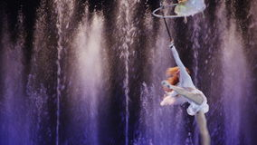 Aerial acrobatics with hoop and hand loop stock video footage