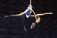 Aerial act duo. Aerial straps duo circus act in a theatre show onboard Liberty of the Seas cruise liner stock photo