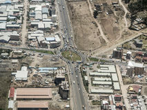 Aerial of Addis Ababa, Ethiopia. Aerial view of highway roundabout and buildings in Addis Ababa, Ethiopia from plane royalty free stock images