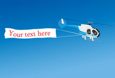 Aerial advertising with helicopter Stock Images