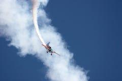 Aerial Aerobatics. A monoplane doing aerial aerobatics Royalty Free Stock Images
