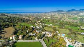 Aerial Akourdalia, Paphos, Cyprus. Aerial bird`s eye view of traditional village Kato Akourdalia, Paphos, Cyprus. The mountains, valley, trees, nature, Latchi Royalty Free Stock Photography