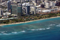 Aerial of Ala Moana Beach Park, mall, condos, and Cityscape of H. Onolulu on Oahu, Hawaii with waves lapping in from the ocean stock image