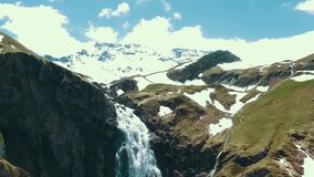 Aerial Alpine mountains, waterfall, snow cap. Mount Rainier and alpine meadows from the Skyline Trail. Aerial view of. Myrtle Falls Mountain Wilderness with stock footage