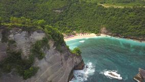 Aerial: Amazing Atuh Beach in Nusa Penida, Indonesia. Drone Fly Over Small Wooden House on the Cliff. 4K. Aerial: Amazing Atuh Beach in Nusa Penida, Indonesia stock footage