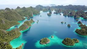 Aerial of Amazing Islands and Lagoon in Wayag, Raja Ampat. Rugged limestone islands, surrounded by coral reefs, are found in an idyllic, tropical lagoon in Wayag stock video