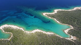 Aerial: amazing white sand beach with clear blue water. Beautiful seascape stock video footage