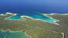 Aerial: amazing white sand beaches with clear blue water. Boats anchored in bay stock video