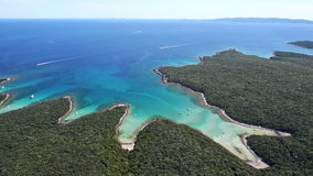 Aerial: amazing white sand beaches and clear blue water. Boats anchored in a bay stock video footage