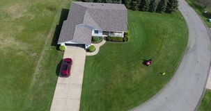 Aerial Angle View Homeowner Mowing Lawn stock video