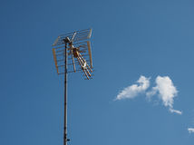 Aerial antenna pole. Aerial antenna for digital terrestrial tv over blue sky Royalty Free Stock Images