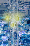 Aerial Antenna telecommunication tower with city behind Stock Image