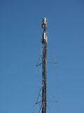 Aerial antenna tower over blue sky Royalty Free Stock Photos