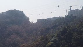 Aerial approach Unique funicular cabin modern cable car. High mountains canyon landscape. Tourism sightseeing. Vietnam. Asia stock footage