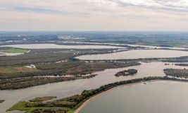 Artificial water basins in the Dutch National Park De Biesbosch. Aerial of artificial water basins in the Dutch National Park De Biesbosch. In the foreground the royalty free stock photos
