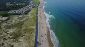 Aerial of Atlantic Ocean and Beach on Cape Cod, MA. Waves from the Atlantic Ocean wash against a scenic beach on Cape Cod, Massachusetts. This sandy peninsula is stock video footage