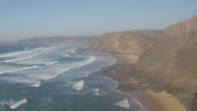 Aerial from the atlantic ocean at Vale Figueiras Portugal stock video footage