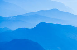 Aerial atmospheric perspective of blue mountain ranges background. Royalty Free Stock Photos