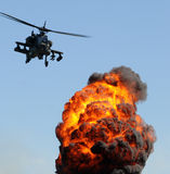 Aerial attack. Attack helicopter delivering fire and smoke Stock Photo