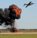 Aerial attack. Air Force jetfighter in bomb drop Royalty Free Stock Image