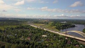 aerial Autofahren durch die Straße im Wald und im Fluss stock video footage