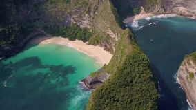 Aerial back tracking on stunning tropical Paradise beach and Cliff in Nusa Penida island of Bali Indonesia of Asia. Aerial back tracking on stunning tropical stock video