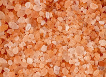 Aerial background macro texture of pink red himalayan salt Stock Image