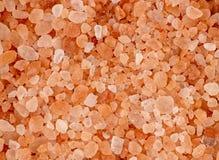 Aerial background macro texture of pink red himalayan salt Stock Image
