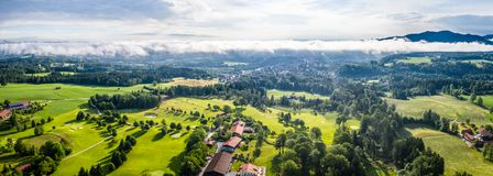 Aerial Bad Toelz Bavarian Alps. Golf Course. Blomberg Mountain. Morning Drone Shot with some clouds in the sky stock images