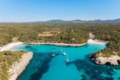 Aerial: The beach of Cala Mondrago in Mallorca, Spain. Aerial: Yachts in the bay of Mallorca in summer Royalty Free Stock Photo