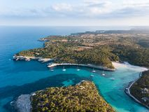 Aerial: The beach of Cala Mondrago in Mallorca, Spain. Aerial: Yachts in the bay of Mallorca in summer Stock Photos