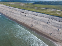 Aerial of Beach on Cape Cod, MA During Summer. Waves from the Atlantic Ocean wash onto a scenic beach on Cape Cod, Massachusetts. This sandy peninsula is a Royalty Free Stock Photo