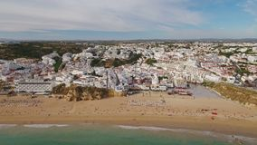 Aerial. Beach fishermen from the sky of Albufeira. Algarve stock footage