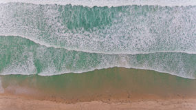 Aerial beach wave on tropical sea Stock Images