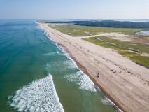 Aerial of Beautiful Beach on Cape Cod, MA. Waves from the Atlantic Ocean wash onto a scenic beach on Cape Cod, Massachusetts. This sandy peninsula is a popular Royalty Free Stock Photos