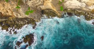 Aerial of beautiful cliffs and waves. Above the sea drone footage. Uluwatu, Bali stock footage