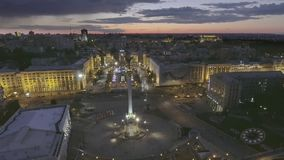 AERIAL. Beautiful fountain at night on Independence Square in Kiev, Ukraine stock video footage