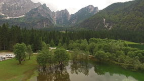 Aerial: Beautiful Mountain Lake Landscape In Belopeska, Italy stock footage