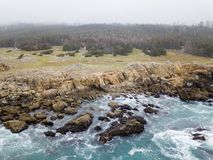 Aerial of Beautiful Northern California Coastline. The cold, nutrient-rich waters of the Pacific Ocean wash against the rocky northern California coastline in stock photography