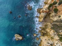 Aerial beautiful rocks and cliffs seascape shore view. Near Albufeira, Algarve, Portugal Royalty Free Stock Image