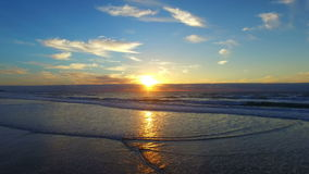 Aerial from a beautiful sunset at the beach in Portugal stock footage