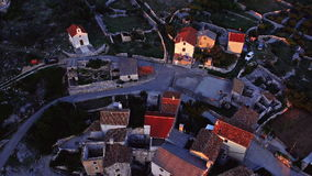 Aerial: beautiful sunset over small adriatic village on top of a hill stock video