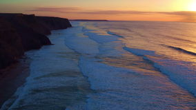Aerial from a beautiful sunset at Vale Figueiras beach. In Portugal stock footage