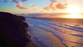 Aerial from a beautiful sunset at Vale Figueiras beach. In Portugal stock video