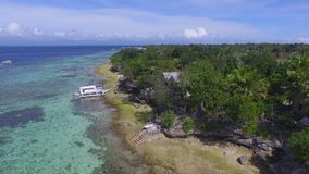 Aerial: Beautiful Tropical Beach Resort In Moalboal, Cebu From Above. Drone Shot Of Beautiful Tropical Beach Resort In Moalboal, Cebu At Summer stock footage