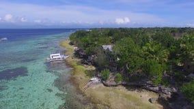 Aerial: Beautiful Tropical Beach Resort In Moalboal, Cebu From Above. Drone Shot Of Beautiful Tropical Beach Resort In Moalboal, Cebu At Summer Day stock video