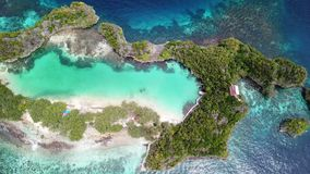 Aerial of Beautiful Tropical Island in Indonesia. A beautiful tropical island in Raja Ampat, Indonesia, are surrounded by calm seas. This unique, equatorial stock footage